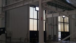 puertas abatibles talleres tranvia bahia de cadiz - norpa puertas y automatismos
